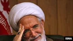 """I will never withdraw,"" says Mehdi Karrubi."