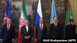 The foreign ministers of the Caspian Sea littoral states -- Sergei Lavrov of Russia (center), Elmar Mammadyarov of Azerbaijan (left), Mohammad Javad Zarif of Iran (second from left), Rashid Meredov of Turkmenistan (right), and Kairat Abdrakhmanov of Kazakhstan -- during a meeting in Moscow on December 5