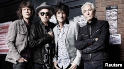 The Rolling Stones pose in front of the Marquee Club in London on July 11, 2012.