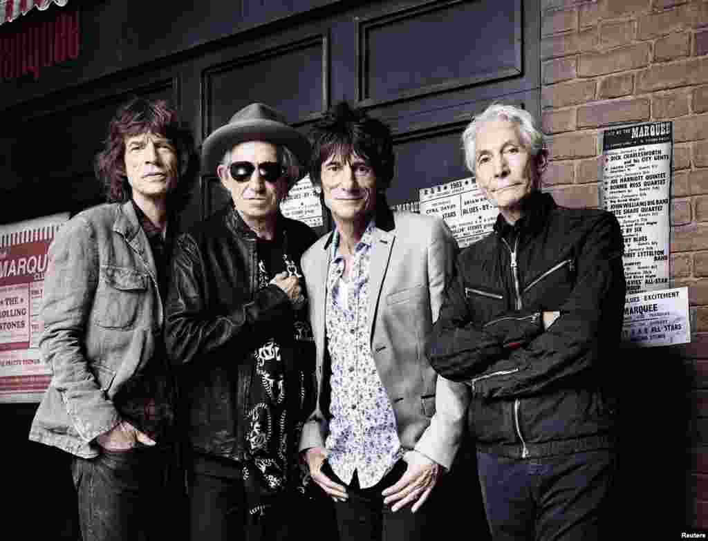The Rolling Stones pose in front of London's Marquee Club -- the scene of their first live gig -- on July 11, 2012.