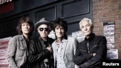 Rolling Stones (Мік Джаґґер, Кіт Річардз, Ронні Вуд, Чарлі Воттс – л-п) перед The Marquee Club у Лондоні напередодні річниці, 11 липня 2012 року
