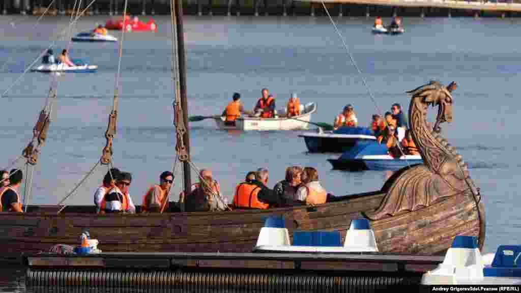 People take boat rides on the lake.