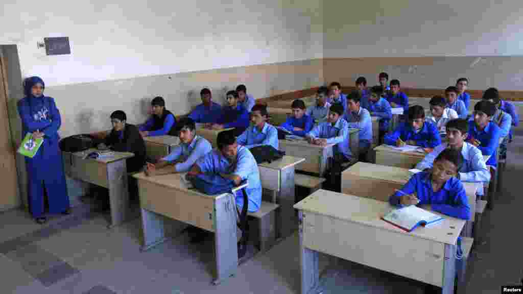Students listen to their teacher at Habibia High School in Kabul.