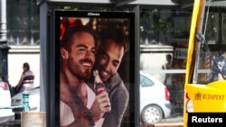 An advertisement promoting gay acceptance, which prompted a political backlash, is seen in Budapest in August 2019.