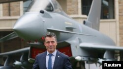 NATO Secretary-General Anders Fogh Rasmussen prepares to speak to the media at the Celtic Manor resort, near Newport, in Wales, September 4, 2014.