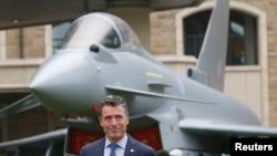 NATO Secretary-General Anders Fogh Rasmussen prepares to speak to the media in Wales.