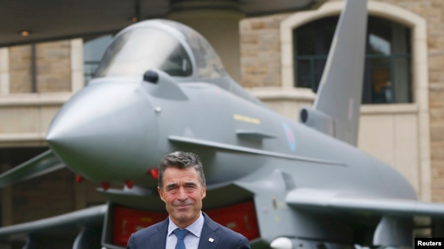 NATO Secretary-General Anders Fogh Rasmussen prepares to speak to the media in Wales.