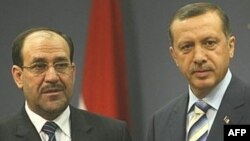 Turkish Prime Minister Recep Tayyip Erdogan (right) has traded barbs with his Iraqi counterpart Nuri al-Maliki in recent weeks.