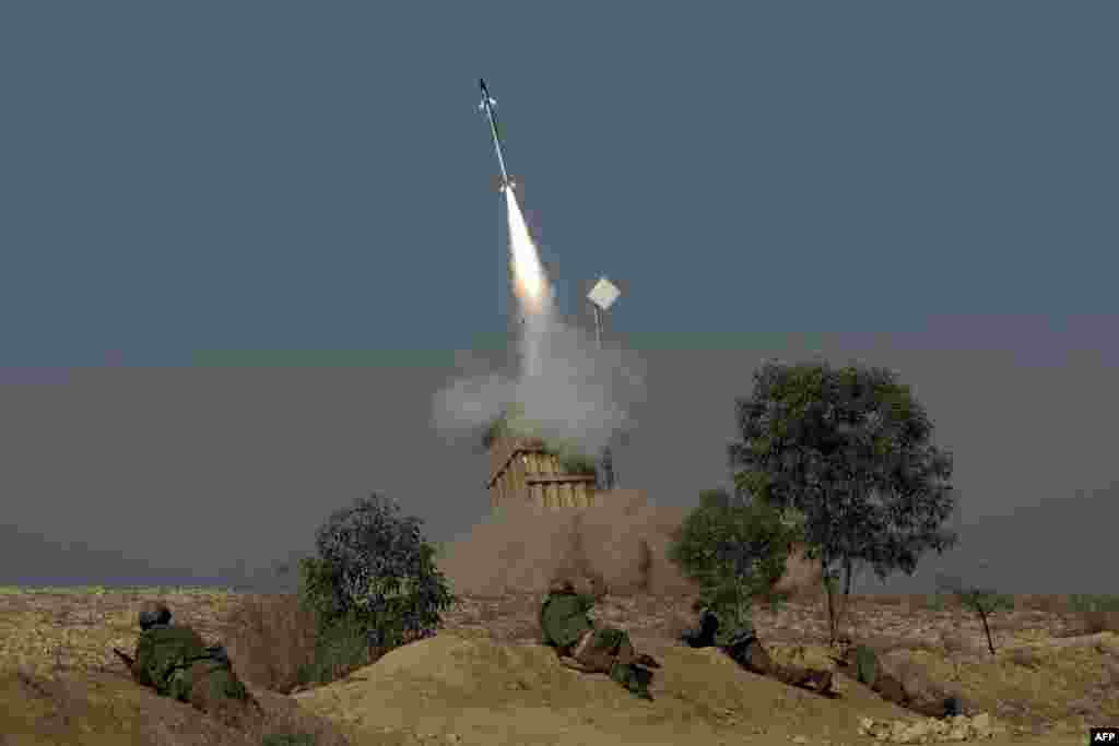 The Israeli military launches a missile from the Iron Dome missile system in the southern Israeli city of Beer Sheva into the Gaza Strip. The UN Security Council held a late-night emergency meeting on the escalating tensions after Israel carried out more than 20 air strikes and sea artillery attacks on Gaza, killing the military commander for Hamas. (AFP/Menahem Kahana)