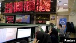 Stock market employees work at Tehran's Stock Exchange. FILE PHOTO