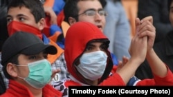 Armenia football fans wear masks to protect against swine flu in Yerevan.