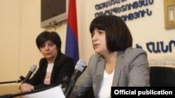 Armenia - Deputy Economy Minister Karine Minasian (R) at a news conference in Yerevan.