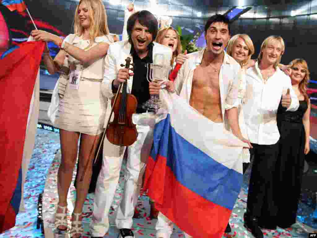 "Popular Russian singer and actor Dima Bilan (holding the flag) made up for the disappointment of being pipped at the post by Finnish rockers Lordi in 2006 when he eventually won the contest with ""Believe"" two years later."