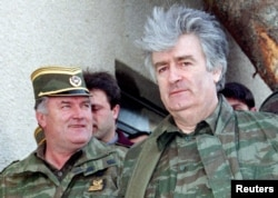 Bosnian Serb wartime leader Radovan Karadzic (right) and his general, Ratko Mladic, in April 1995. Both men received lengthy sentences for the gravest crimes that came under the purview of the Hague tribunal.