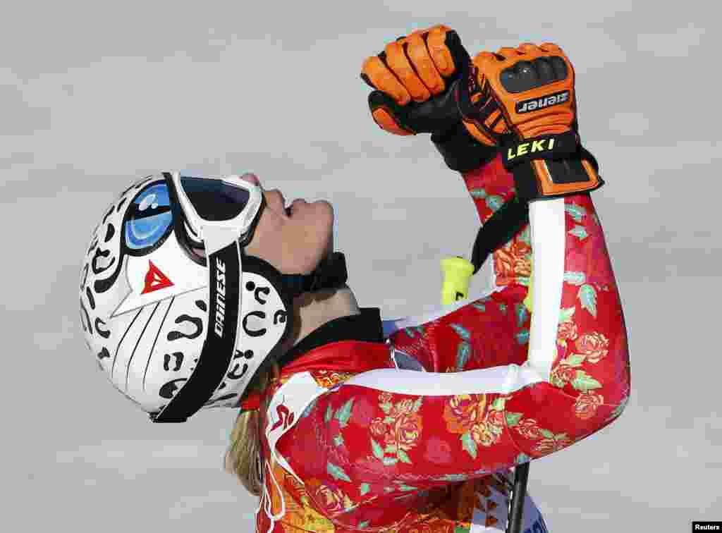 Germany's Maria Hoefl-Riesch reacts in the finish area during the women's alpine skiing Super G competition. She won the silver medal. (REUTERS/Leonhard Foeger)