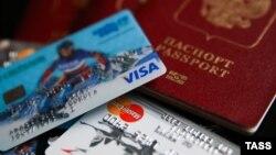 Генбанк: рішення про припинення обслуговування карт Visa та MasterCard ухвалили через санкції 2014 року