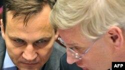 Радослав Сикорский (слева), Карл Бильдт (справа)