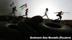 Protestuesit palestinezë në përleshjet rreth kufirit, Gaza-Izrael.