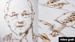 """Картина, изображающая министра обороны Литвы при помощи """"золотых"""" приборов"""