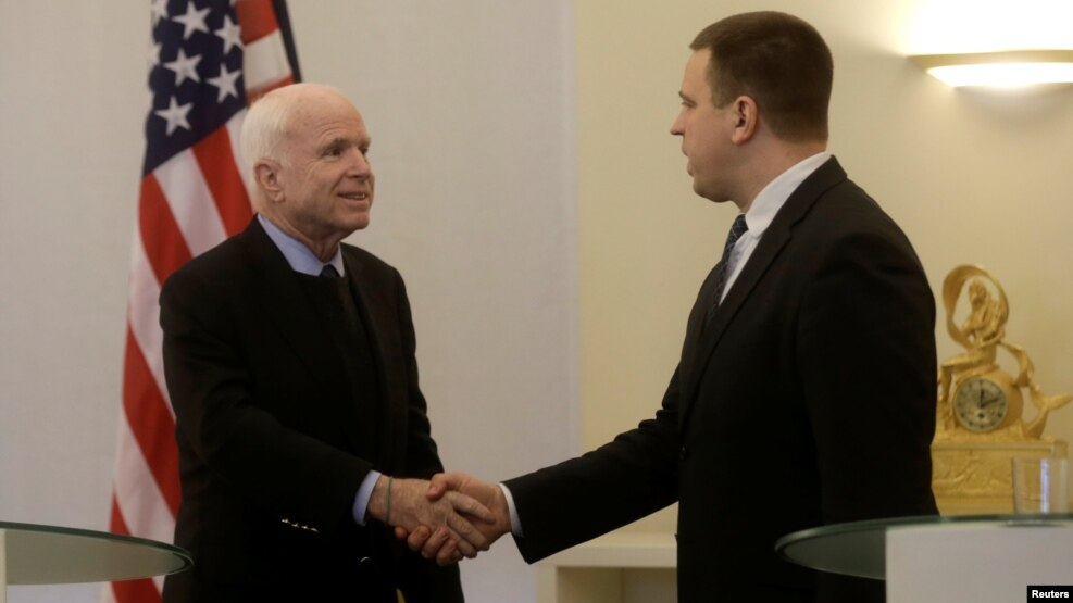 U.S. Senator John McCain shakes hands with Estonia's Prime Minister Juri Ratas in Tallinn, Estonia, on December 27.
