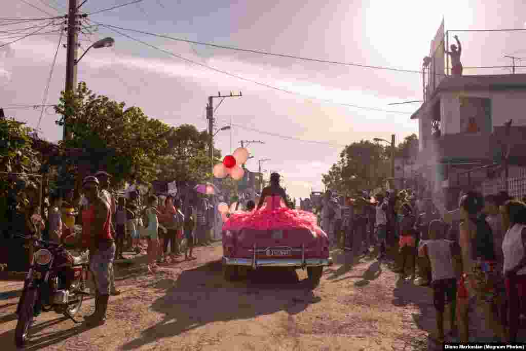 Pura rides around her neighborhood in a pink 1950s convertible, as the community gathers to celebrate her fifteenth birthday, in Havana, Cuba.  Contemporary Issues: First Prize, Singles - Diana Markosian, Magnum Photos