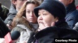 Belgium - Uzbek human rights activist Mutabar Tajibayeva in Brussels FIDH protest, 24Jan2011