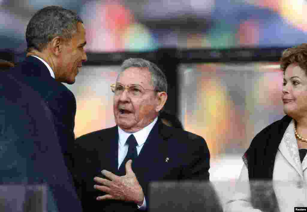 U.S. President Barack Obama greets Cuban President Raul Castro before delivering a speech.