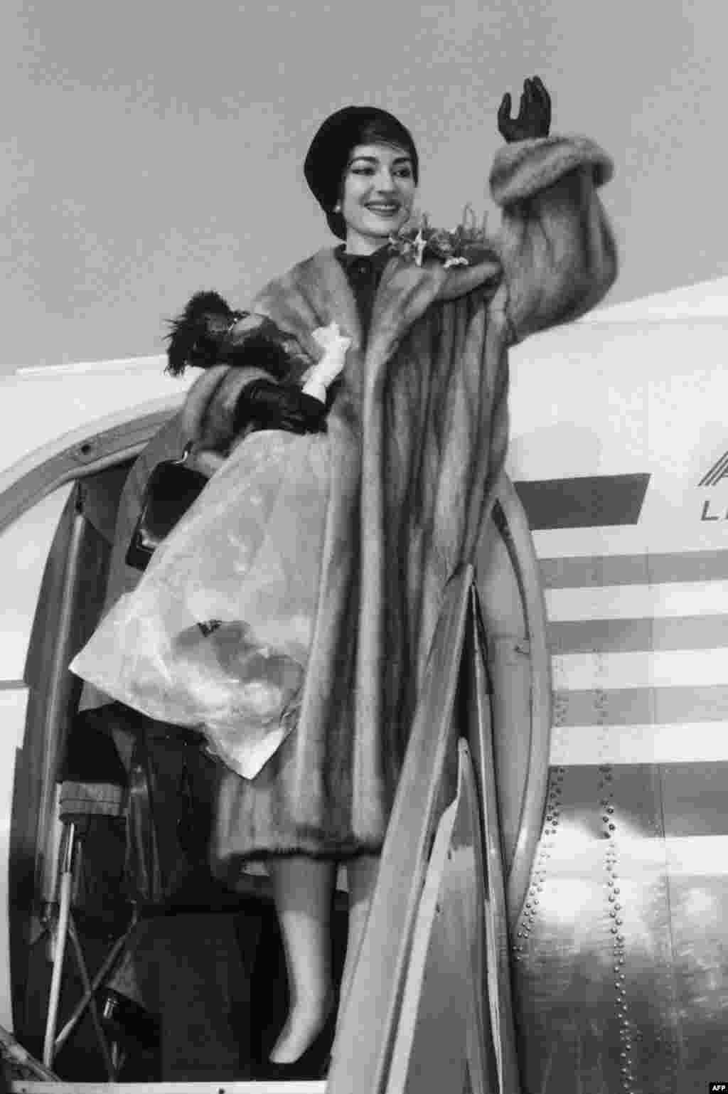 Maria Callas waving as she arrives at Milan's Malpensa airport on January 16, 1958