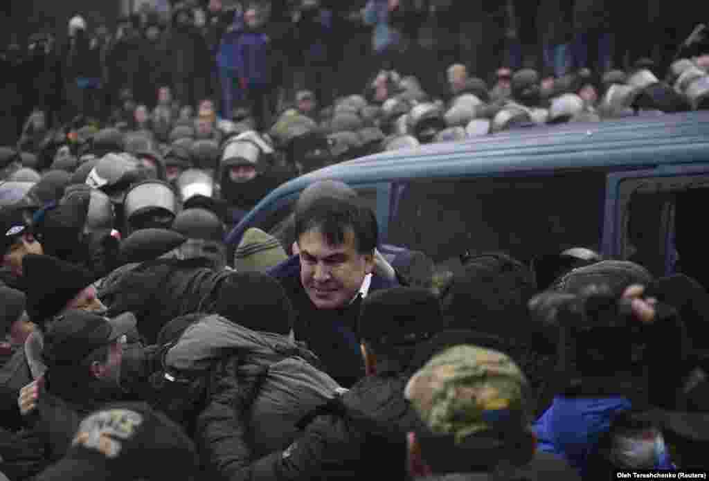(2/2) Saakashvili was later dramatically freed from custody by his supporters, who surrounded a police van. He vowed to continue to resist arrest. (Reuters/Oleh Tereshchenko)