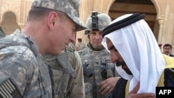 Al-Anbar provincial tribe leader Sheikh Abdul-Sattar Abu Risha with U.S. commander General David Petraeus (file photo)