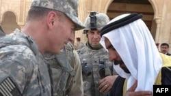 Al-Anbar provincial tribe leader Sheikh Abdul-Sattar Abu Risha with U.S. commander General David Petraeus (file photo)