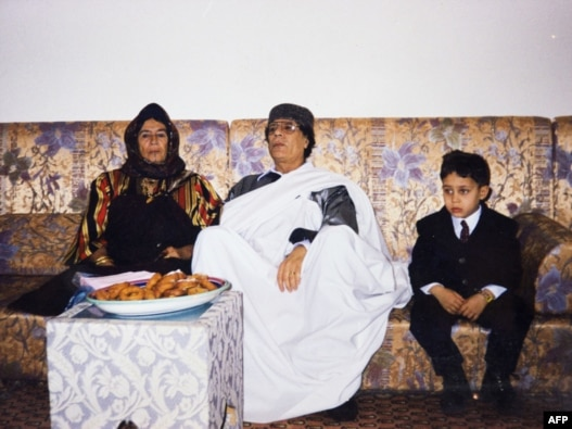 An undated photo shows Muammar Qaddafi during a family visit. The photo was found in a family album at his wrecked former headquarters at Tripoli's Bab al-Aziziya compound on August 28.