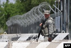 """Один из последних солдат армии США в Киргизии. База """"Манас"""", июнь 2014 года"""