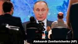 Russian President Vladimir Putin speaks via video call during his annual news conference in Moscow on December 17.