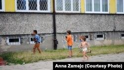 Children play outside an asylum-seekers' center in Bialystok.