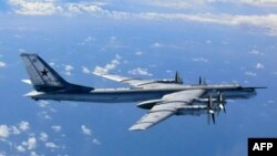 A Russian TU-95 flies in airspace near the isle of Okinoshima in western Japan in August 2013.