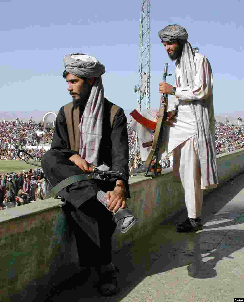 "Taliban gunmen watching a football match in Kabul. Football was highly popular, especially after allegedly ""un-Islamic"" pastimes like kite flying and buzkashi were banned, but most sports faced restrictions."
