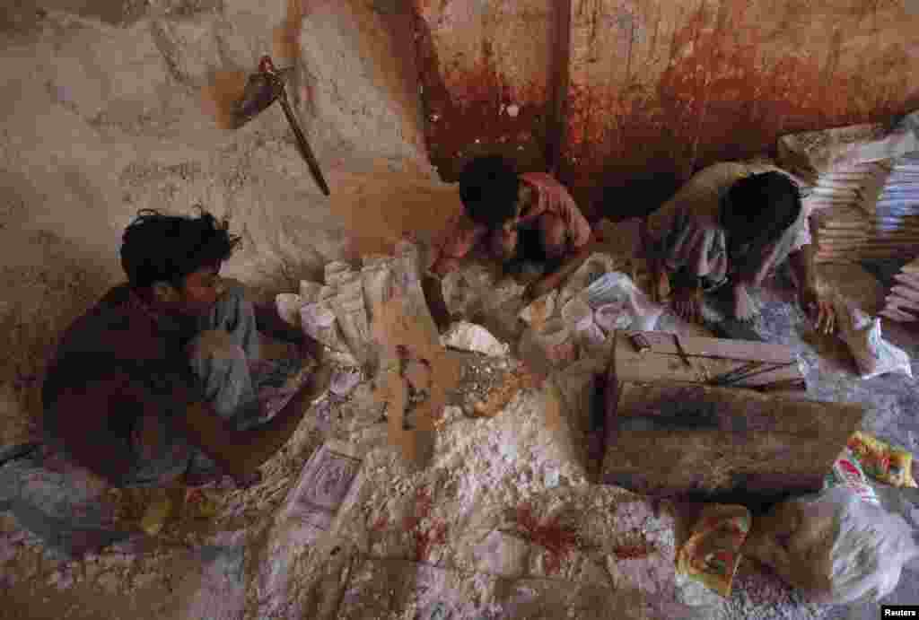 Workers pack pink salt at a factory to be sold at markets in Karachi.