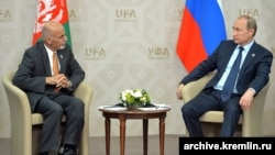 FILE: Russian President Vladimir Putin with the Afghan President Ashraf Ghani in July 2015.