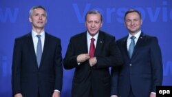 Polish President Andrzej Duda (right) and NATO Secretary General Jens Stoltenberg (left) welcome Turkish President Recep Tayyip Erdogan (center) at the opening of the NATO Summit in Warsaw on July 8.
