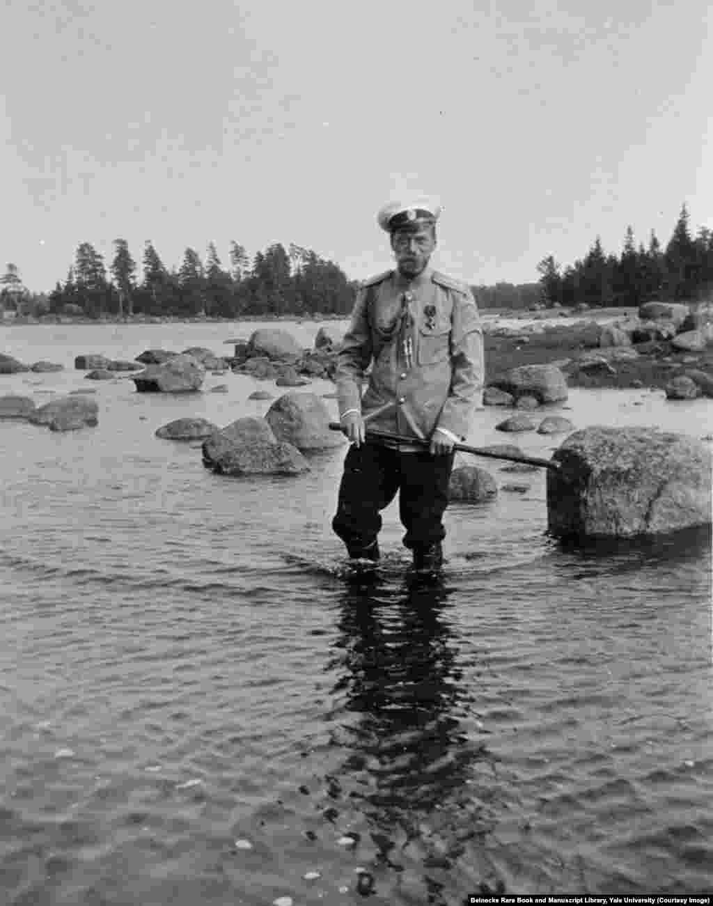 "Tsar Nicholas II wading on the rocky shore of Finland. After the early death of his father, he confided to a friend, ""I am not yet ready to be tsar. I know nothing of the business of ruling."""