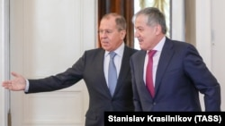 Russian Foreign Minister Sergei Lavrov (left) and his Tajik counterpart, Sirojidin Aslov, meet in Moscow on April 9.