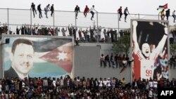 Партрэт караля Абдалы ІІ падчас футбольнага матчу паміж Японіяй і Ярданіяй