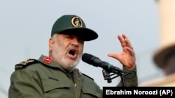 Revolutionary Guards head Hossein Salami speaking at the pro-government rally in Tehran on November 25.