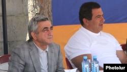 Armenia - President Serzh Sarkisian (L) and businessman Gagik Tsarukian watch a sporting competition in Tsaghkadzor, 14Jul2012.