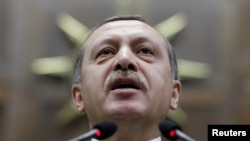 Turkey -- Prime Minister Tayyip Erdogan addresses members of parliament from his ruling AK Party during a meeting at the parliament in Ankara, 02Mar2010