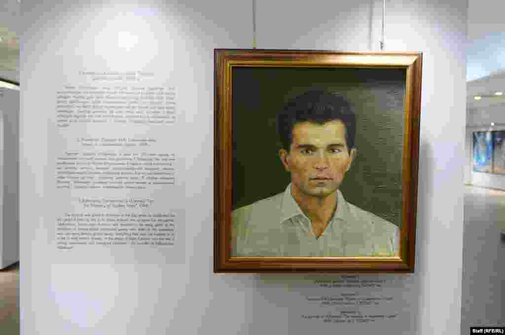 "A portrait of a young Islam Karimov titled ""For the Memory of Student Years"" at the entrance to the exhibition. Born in Samarkand, Karimov studied economics before making his way up the ranks of Soviet planners."