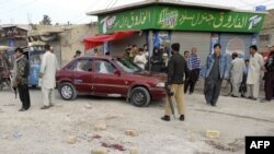 Pakistani police stand guard at the site of an attack by gunmen in Quetta on March 29.