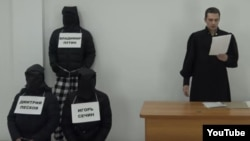The video features Karim Yamadayev dressed as a judge reading death sentences.