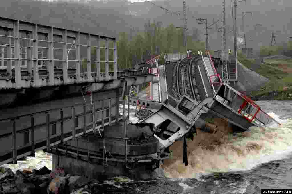 A view shows a railway bridge across the Kola River that collapsed after its foundations were washed away by rapidly melting snow and strong flows of water, near Murmansk, on June 3. (TASS/Lev Fedoseyev)